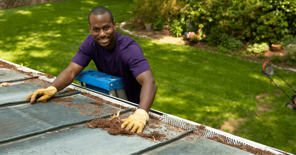 cleaning gutters with a leaf guard installed